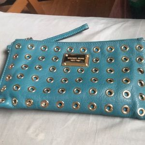 Great used condition MK teal large wristlet!